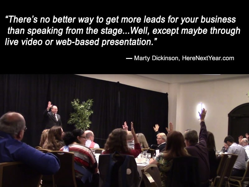 Marty Dickinson speaking on stage at district Toastmasters event