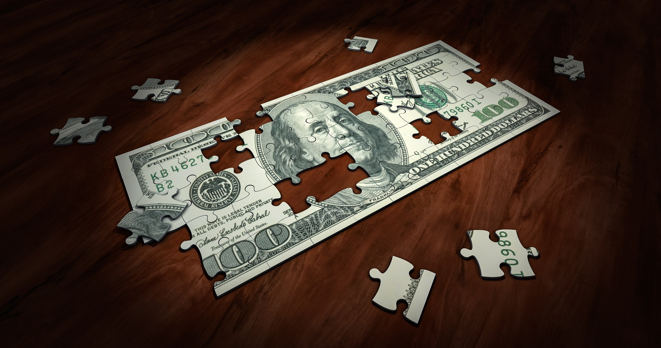 Image of $100 bill in puzzle pieces to symbolize business strategy 2020