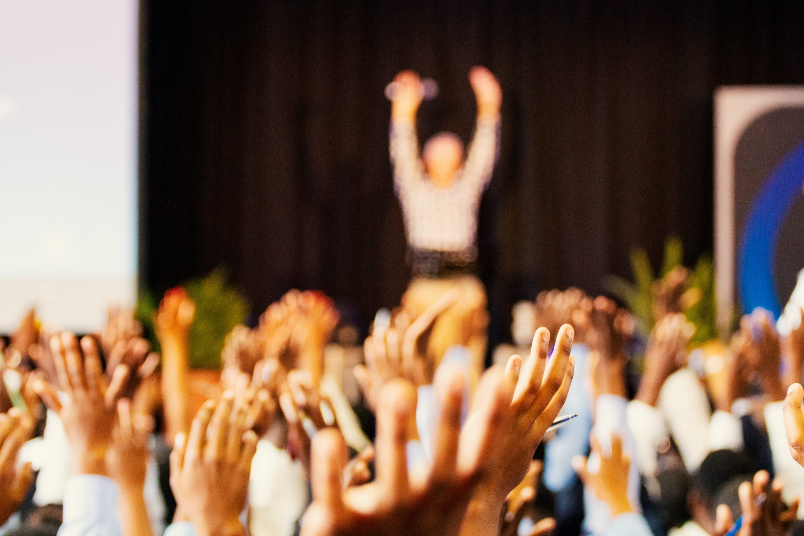 Professional speaker showing in-person speaking and engaging audience