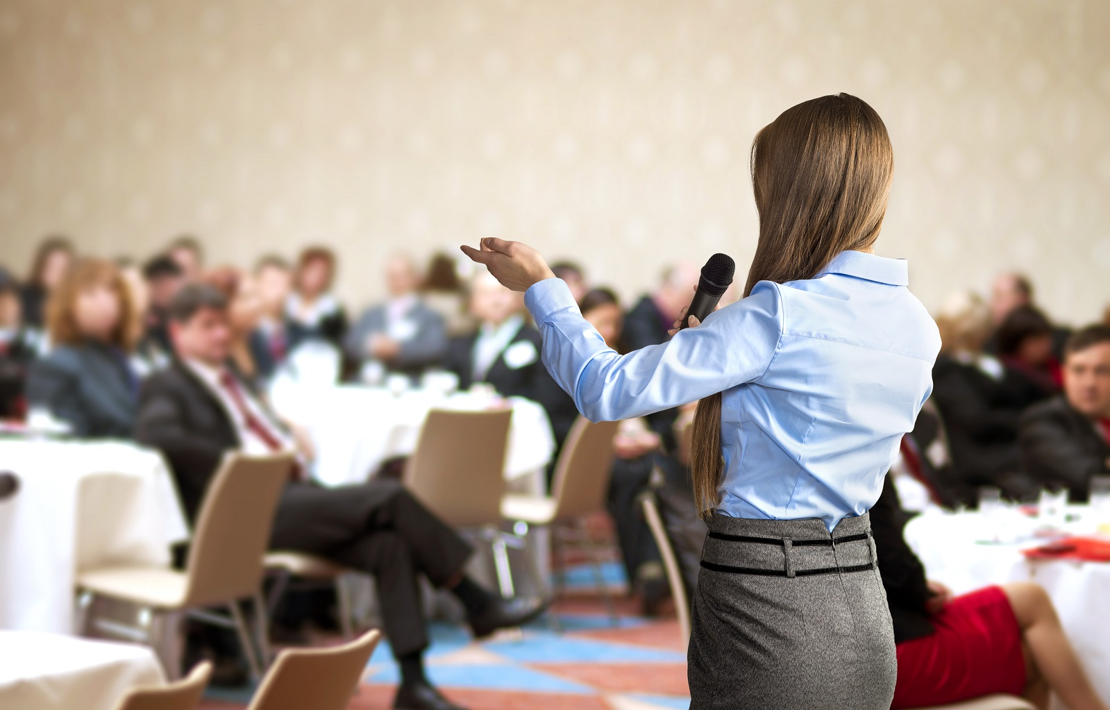 Get speaking to corporate and company audiences woman speaking to corporate