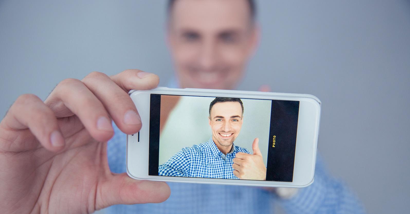Video Testimonial Examples showing man making video testimonial on cell phone